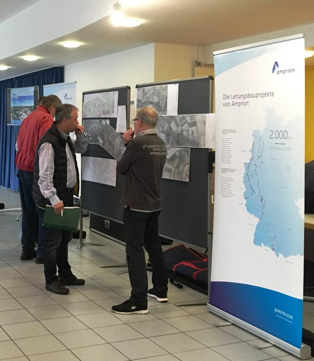 Amprion auf Infotour für geplante Verstärkung der bestehenden 380-kV-Leitung zwischen Kühmoos und Maximiliansau in Süd-Baden und Südpfalz | Büro Hitschfeld